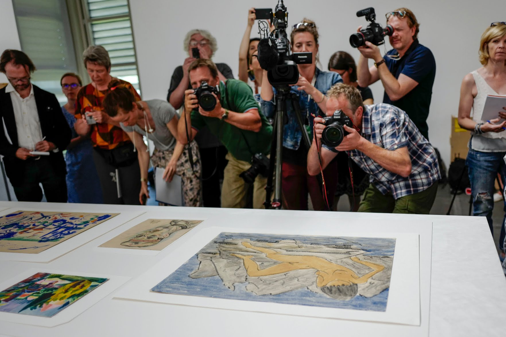 Journalists film, take picture and look at the pieces of a art during the press preview of the first masterpieces of the estate of German collector Cornelius Gurlitt at the Museum of Fine Arts Bern (Kunstmuseum Bern) on July 7, 2017 in Bern. Photo credit should read Valeriano Di Domenico/AFP/Getty Images.